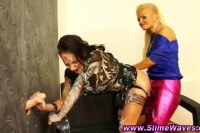 Strapon loving lesbians getting messy by the gloryhole