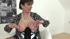 Busty mature Lady Sonia posing
