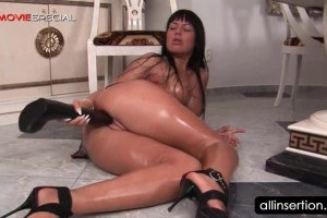 Magnificent brunette toying herself with a huge black dildo