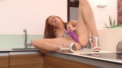 Redhead beauty takes toy deep