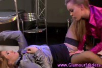 Two satin clothed divas having lesbian sex on the stage