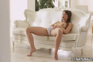 Enticing brunette touches herself so sensually