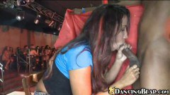 Slutty redhead sucking on a stripper's black cock