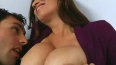 Dazzling MILF with round boobs sucks a hard cock