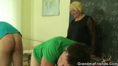 Kinky old teacher handles two young cocks