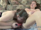 Two delicious lesbos having sex with a dildo