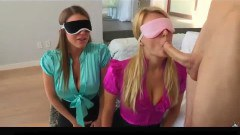 Two passionate MILFs sharing a cock blindfolded
