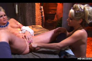 Two stunning lesbians with green dildo
