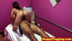 Lovely oriental masseuse tugging her client