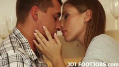 Classy beauty in footjob action