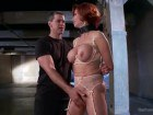 Wild busty redhead slave in action