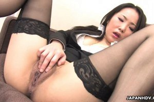 Magnetic Asian babe in stockings fingering her cunt