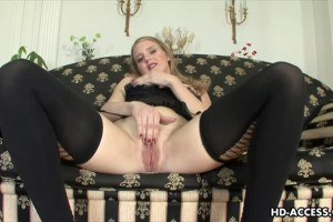 Heavenly blonde having an orgasm on the sofa