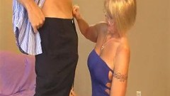 Blonde granny sucking on a client