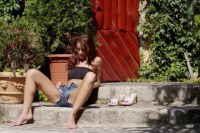 Dark hair slut fingering pussy outdoor