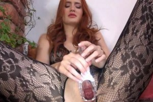 Gorgeous redhead stimulating her pussy