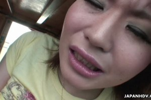 Oriental cute uses a vibrator on a boat