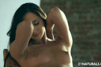 Radiant brunette Aruna Aghore goes solo