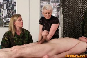 Two chicks wanking on a dude