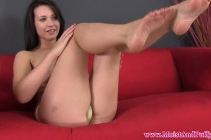 Horny brunette toying on her pussy