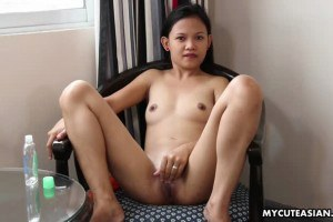 Wide eyed Asian honey toying her wet tight hole