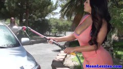 Two busty lesbans in carwash sex