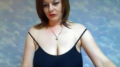 Busty mom exposed on cam