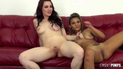 Interracial lesbian couple toying on red couch
