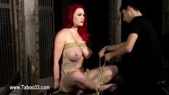 Redhead beauty gets bound