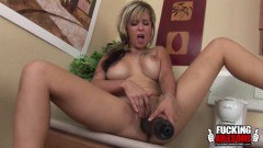 Horny blonde housewife takes a huge toy deep