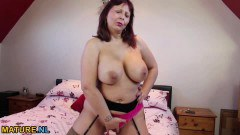 Redhead mature in lingerie pleasures her pussy