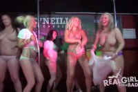 Topless amateurs get hosed on stage at a party