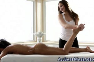 Brunette lesbian masseuse facesitting with ebony client