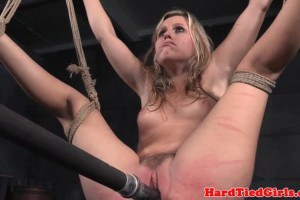 Blonde BDSM sub flogged after chocking on a dildo