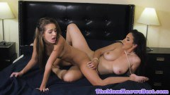 Teen and MILF lesbians scissoring like wild on the bed