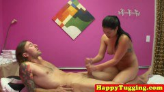 Curvy oriental masseuse makes client jizz with tugging session