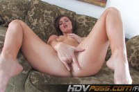 Tempestuous brunette Lily Carter fingers her snatch