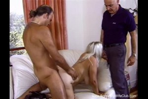 Busty blonde swinger shared between two strangers