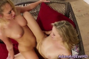 Busty blonde babe scissors her naughty girlfriend on the sofa