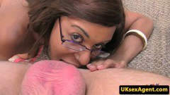 Ebony amateur with glasses rims agent's ass and licks balls