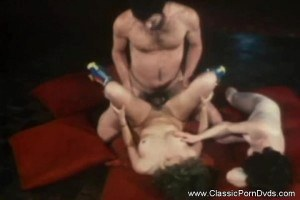 Retro 70's chick sucking on dicks and getting fucked in group