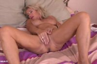 Tempting blonde MILF rubs pussy during solo