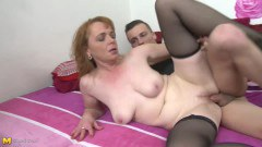 Giant titted dark-haired cougar fucks in fishnets