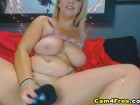 Blonde amateur with giant titties uses a big dildo on cam