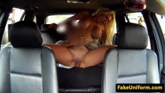 Busty Brit blondie sucks and rides officer's cock in the patrol car