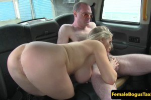 Rebecca More ultra busty British cab driver sucks and tugs on the backseat
