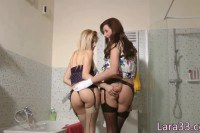 Lara Latex and her girlfriend in stockings making those pussies happy