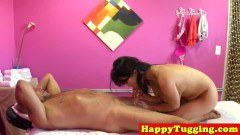 Asian masseuse blowing client on the rubbing table