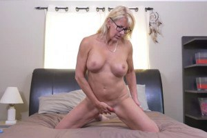 Busty blonde Canadian mature with glasses gets herself off