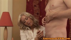 Cougarmom beauty savoring CFNM handjob fun in close up